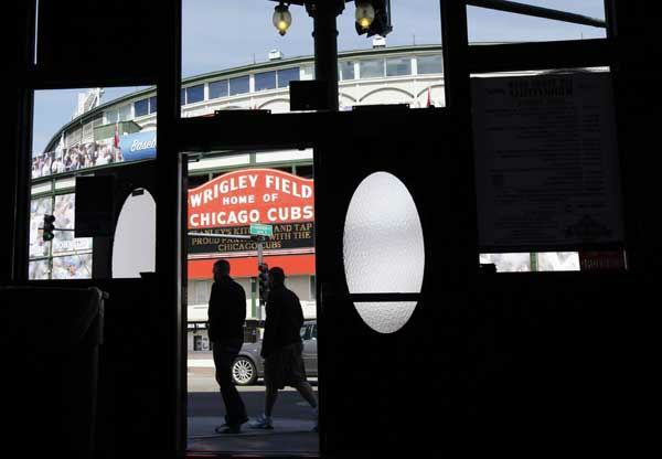 People walk by Wrigley Field, home of the Chicago Cubs, Wednesday, April 4, 2012, before Thursday&#39;s opening day baseball game against the Washington Nationals in Chicago. The Cubs, one of the most popular and lucrative sports franchises in the United States despite their unmatched record of failure, may be getting financial help to renovate historic Wrigley Field from its cash-strapped city. Send your photos from Wrigley Field to useeit@abc7chicago.com!  <span class=meta>(AP Photo&#47;Nam Y. Huh)</span>