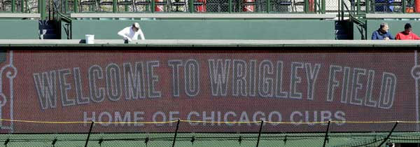 A worker paints around a new digital screen installed in right field at Wrigley Field in Chicago, Wednesday, April 4, 2012, the day before the Chicago Cubs opening day baseball game against the Washington Nationals. Send your photos from Wrigley Field to useeit@abc7chicago.com!  <span class=meta>(AP Photo&#47;Nam Y. Huh)</span>