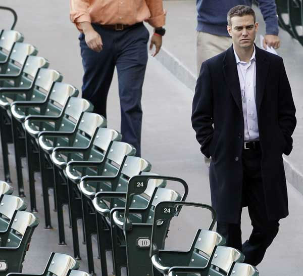 Chicago Cubs president Theo Epstein walks through the stands at Wrigley Field in Chicago, Wednesday, April 4, 2012, the day before the Cubs open their season against the Washington Nationals. &#40;AP Photo&#47;Nam Y. Huh&#41; <span class=meta>(AP Photo)</span>