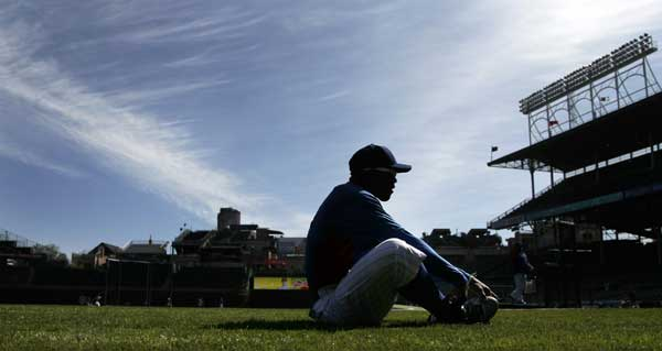 Chicago Cubs center fielder Marlon Byrd stretches before an opening day baseball game against the Washington Nationals, Thursday, April 5, 2012, in Chicago.  <span class=meta>(AP Photo&#47;Charles Rex Arbogast)</span>