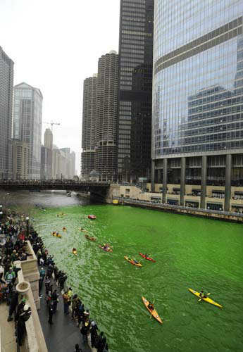 The Chicago River is dyed green right before the start of the St. Patrick&#39;s Day parade in Chicago, Saturday, March, 16, 2013.  With the holiday itself falling on a Sunday, many celebrations were scheduled instead for Saturday because of religious observances. &#40;AP Photo&#47;Paul Beaty&#41; <span class=meta>(AP Photo&#47; PAUL BEATY)</span>
