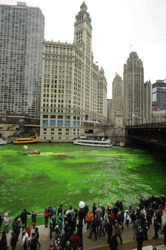 "<div class=""meta ""><span class=""caption-text "">Bystanders look on as the Chicago River is dyed green ahead of the St. Patrick's Day parade in Chicago, Saturday, March, 16, 2013.  With the holiday itself falling on a Sunday, many celebrations were scheduled instead for Saturday because of religious observances. (AP Photo/Paul Beaty) (AP Photo/ PAUL BEATY)</span></div>"