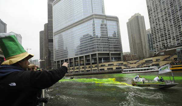 Bystanders look on as the Chicago River is dyed green ahead of the St. Patrick&#39;s Day parade in Chicago, Saturday, March, 16, 2013.  With the holiday itself falling on a Sunday, many celebrations were scheduled instead for Saturday because of religious observances. &#40;AP Photo&#47;Paul Beaty&#41; <span class=meta>(AP Photo&#47; PAUL BEATY)</span>