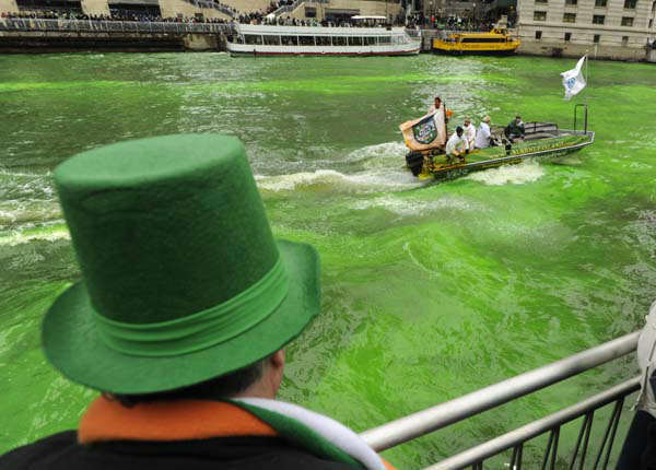 "<div class=""meta ""><span class=""caption-text "">A spectator looks on as the Chicago River is dyed green ahead of the St. Patrick's Day parade in Chicago, Saturday, March, 16, 2013. With the holiday itself falling on a Sunday, many celebrations were scheduled  for Saturday because of religious observances. (AP Photo/Paul Beaty) (AP Photo/ PAUL BEATY)</span></div>"