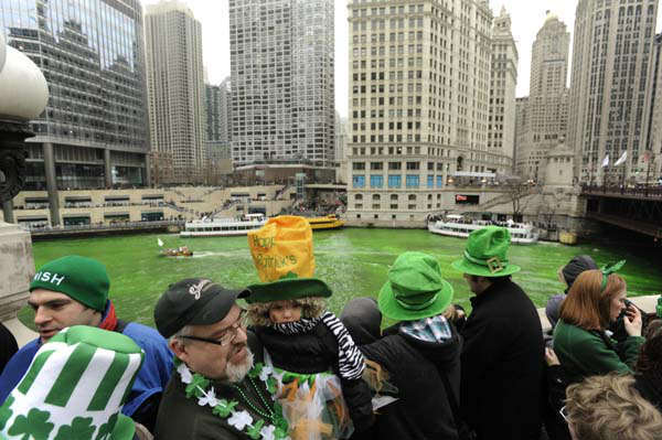 Spectators watch as the Chicago River is dyed green ahead of the St. Patrick&#39;s Day parade in Chicago, Saturday, March, 16, 2013.  With the holiday itself falling on a Sunday, many celebrations were scheduled instead for Saturday because of religious observances. &#40;AP Photo&#47;Paul Beaty&#41; <span class=meta>(AP Photo&#47; PAUL BEATY)</span>