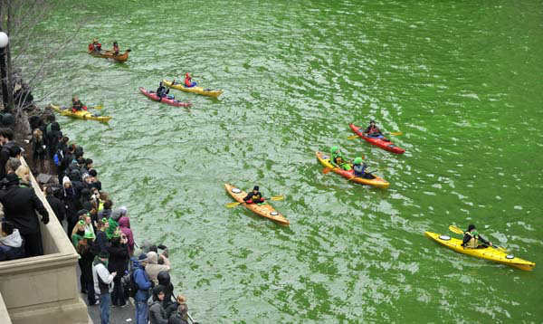 Spectators watch as the Chicago River is dyed green right before the start of the St. Patrick&#39;s Day parade in Chicago, Saturday, March, 16, 2013.  With the holiday itself falling on a Sunday, many celebrations were scheduled instead for Saturday because of religious observances. &#40;AP Photo&#47;Paul Beaty&#41; <span class=meta>(AP Photo&#47; PAUL BEATY)</span>