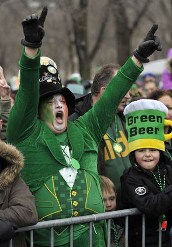 David Westerby of Kenosa, Wis. left, yells during the St. Patrick&#39;s Day parade in Chicago, Saturday, March, 16, 2013.   With the holiday itself falling on a Sunday, many celebrations were scheduled instead for Saturday because of religious observances. &#40;AP Photo&#47;Paul Beaty&#41; <span class=meta>(AP Photo&#47; PAUL BEATY)</span>