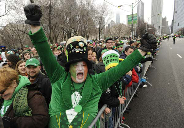 "<div class=""meta ""><span class=""caption-text "">David Westerby of Kenosa, Wis. left, yells during the St. Patrick's Day parade in Chicago, Saturday, March, 16, 2013.  With the holiday itself falling on a Sunday, many celebrations were scheduled instead for Saturday because of religious observances. (AP Photo/Paul Beaty) (AP Photo/ PAUL BEATY)</span></div>"