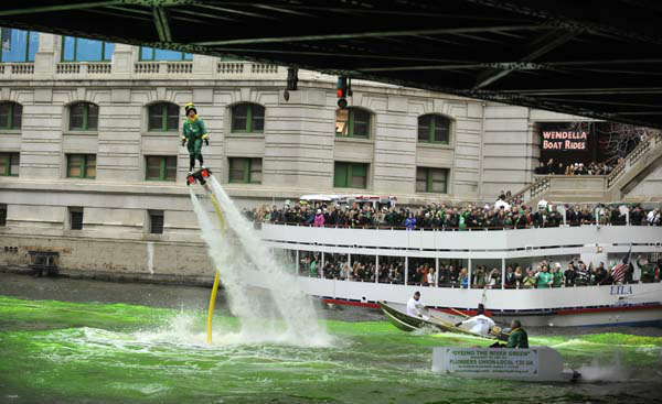 "<div class=""meta image-caption""><div class=""origin-logo origin-image ""><span></span></div><span class=""caption-text"">Spectators watch as the the Chicago River is dyed green ahead of the St. Patrick's Day parade in Chicago, Saturday, March, 16, 2013.  With the holiday itself falling on a Sunday, many celebrations were scheduled instead for Saturday because of religious observances. (AP Photo/Paul Beaty) (AP Photo/ PAUL BEATY)</span></div>"