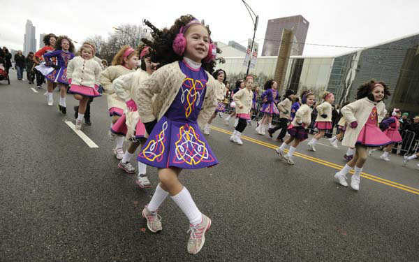 Dancers from the Tooromeen School of Dance perform during the St. Patrick&#39;s Day parade in Chicago, Saturday, March, 16, 2013. &#40;AP Photo&#47;Paul Beaty&#41; <span class=meta>(AP Photo&#47; PAUL BEATY)</span>