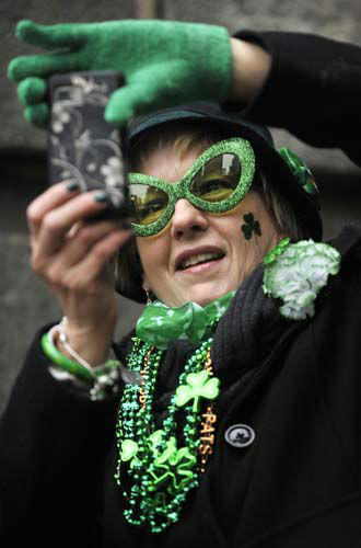 Patricia Dunne of Detroit, Mi. photographs The Chicago River being dyed green ahead of the St. Patrick&#39;s Day parade in Chicago, Saturday, March, 16, 2013. &#40;AP Photo&#47;Paul Beaty&#41; <span class=meta>(AP Photo&#47; PAUL BEATY)</span>