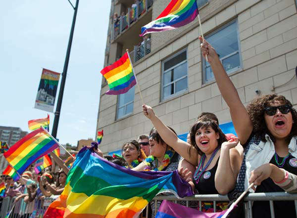 Spectators watch the Chicago Gay Pride Parade on Broadway Street in Chicago, Sunday, June 30, 2013. &#40;AP Photo&#47;Scott Eisen&#41; <span class=meta>(AP Photo&#47; Scott Eisen)</span>