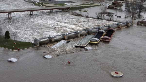 "<div class=""meta ""><span class=""caption-text "">This Thursday, April 18, 2013 aerial photo provided by the U.S. Coast Guard shows the dam in Marseilles, Ill., after seven barges broke free from a tow and came to rest against the dam. Rapid currents from this week's heavy rainstorms are blamed for the incident. The Coast Guard says the dam sustained minor damage but there were no reports of breaches in the structure or surrounding levees. No one was injured. Authorities evacuated as many as 1,500 residents of the northern Illinois city. (AP Photo/Courtesy of the U.S. Coast Guard, Petty Officer 3rd Class John Schleicher) (AP Photo/ John Schleicher)</span></div>"