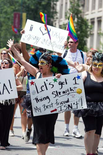 "<div class=""meta ""><span class=""caption-text "">Participants march in the Chicago Gay Pride Parade with signs to support friends and family in Chicago, Sunday, June 30, 2013. (AP Photo/Scott Eisen) (AP Photo/ Scott Eisen)</span></div>"