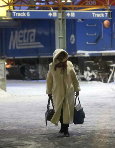 A woman walks to the waiting room as she arrives at the La Salle Street commuter rail station with temperatures well below zero and wind chills expected to reach 40 to 50 below, Monday, Jan. 6, 2014, in Chicago. &#40;AP Photo&#47;Charles Rex Arbogast&#41; <span class=meta>(Photo&#47;Charles Rex Arbogast)</span>