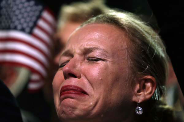 A supporter cries as President Barack Obama speaks during an election night party, Wednesday, Nov. 7, 2012, in Chicago. Obama defeated Republican challenger former Massachusetts Gov. Mitt Romney to win re-election. &#40;AP Photo&#47;Matt Rourke&#41; <span class=meta>(AP Photo&#47; Matt Rourke)</span>