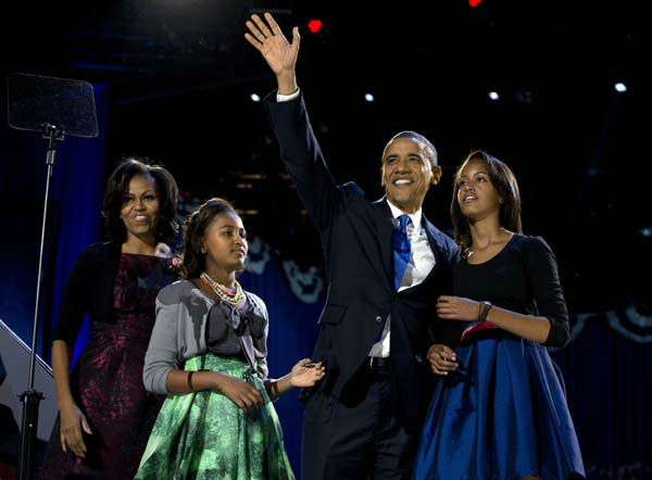 President Barack Obama waves as he walks on stage with first lady Michelle Obama and daughters Malia and Sasha at his election night party Wednesday, Nov. 7, 2012, in Chicago. Obama defeated Republican challenger former Massachusetts Gov. Mitt Romney. &#40;AP Photo&#47;Carolyn Kaster&#41; <span class=meta>(AP Photo&#47; Carolyn Kaster)</span>