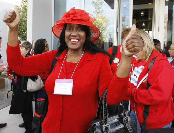 Mary Edmonds, a member of the Chicago Teachers Union&#39;s House of Delegates, celebrates after the delegates voted to suspend the strike against the school district Tuesday, Sept. 18, 2012, in Chicago. The city&#39;s teachers agreed to return to the classroom after more than a week on the picket lines, ending a spiteful stalemate with Mayor Rahm Emanuel that put teacher evaluations and job security at the center of a national debate about the future of public education. &#40;AP Photo&#47;Charles Rex Arbogast&#41; <span class=meta>(AP Photo&#47; Charles Rex Arbogast)</span>