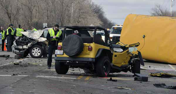 "<div class=""meta image-caption""><div class=""origin-logo origin-image ""><span></span></div><span class=""caption-text"">Investigators gather evidence from the scene of a three vehicle accident, including a school bus where the driver of a Jeep Wrangler was killed on Friday, April 5, 2013, near Wadsworth, Ill.  Over two dozen school children were on the bus, most receiving minor injuries. (AP Photo/Jim Prisching) (AP Photo/ Jim Prisching)</span></div>"