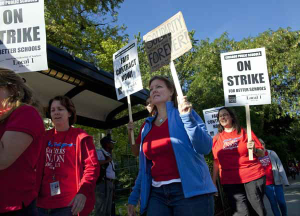 Public school teachers picket outside Amundsen High School on the first day of a strike by the Chicago Teachers Union, Monday, Sept. 10, 2012, in Chicago. The school is one of more than 140 schools in the Chicago Public Schools&#39; &#34;Children First&#34; contingency plan, which feeds and houses students for four hours during the strike. &#40;AP Photo&#47;Sitthixay Ditthavong&#41; <span class=meta>(AP Photo&#47; Sitthixay Ditthavong)</span>