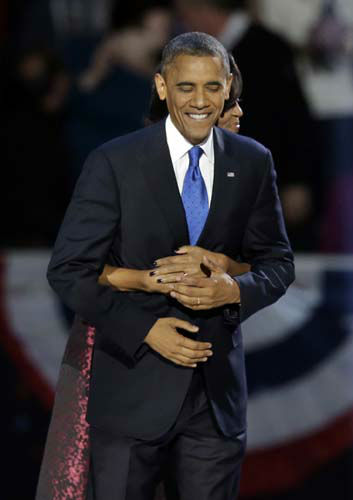 President Barack Obama gets a hug from first lady Michelle Obama at his election night party Wednesday, Nov. 7, 2012, in Chicago. President Obama defeated Republican challenger former Massachusetts Gov. Mitt Romney. &#40;AP Photo&#47;Chris Carlson&#41; <span class=meta>(AP Photo&#47; Chris Carlson)</span>