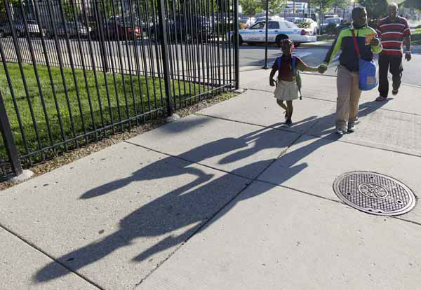 "<div class=""meta image-caption""><div class=""origin-logo origin-image ""><span></span></div><span class=""caption-text"">Parents drop their children off at Benjamin E. Mays Academy one of the few schools open for a half day during the first day of a Chicago teachers strike, Monday, Sept. 10, 2012. in Chicago. Thousands of teachers walked off the job in the nation's third-largest school district for the first time in 25 years after union leaders announced they were far from resolving a contract dispute with school district officials. (AP Photo/M. Spencer Green) (AP Photo/ M. Spencer Green)</span></div>"
