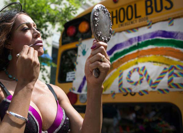 Bianco Torres looks in a mirror while applying makeup prior to participating in the Chicago Gay Pride Parade in Chicago, Sunday, June 30, 2013. &#40;AP Photo&#47;Scott Eisen&#41; <span class=meta>(AP Photo&#47; Scott Eisen)</span>