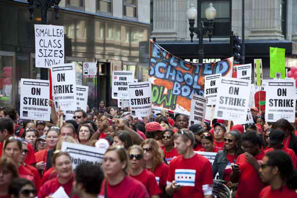 Thousands of public school teachers march on streets surrounding the Chicago Public Schools district headquarters on the first day of strike action over teachers&#39; contracts on Monday, Sept. 10, 2012 in Chicago. For the first time in a quarter century, Chicago teachers walked out of the classroom Monday, taking a bitter contract dispute over evaluations and job security to the streets of the nation&#39;s third-largest city ? and to a national audience ? less than a week after most schools opened for fall.  &#40;AP Photo&#47;Sitthixay Ditthavong&#41; <span class=meta>(AP Photo&#47; Sitthixay Ditthavong)</span>