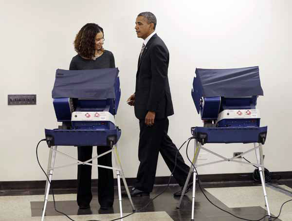 President Barack Obama walks away from the voting machine after casting his vote, during early voting, in the 2012 election at the Martin Luther King Community Center, Thursday, Oct. 25, 2012, in Chicago. &#40;AP Photo&#47;Pablo Martinez Monsivais&#41; <span class=meta>(AP Photo&#47; Pablo Martinez Monsivais)</span>