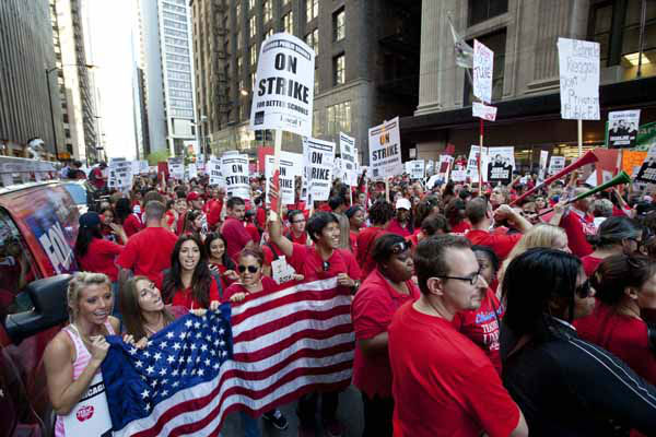 "<div class=""meta ""><span class=""caption-text "">Thousands of public school teachers rally outside the Chicago Public Schools district headquarters on the first day of strike action over teachers' contracts on Monday, Sept. 10, 2012 in Chicago. For the first time in a quarter century, Chicago teachers walked out of the classroom Monday, taking a bitter contract dispute over evaluations and job security to the streets of the nation's third-largest city ? and to a national audience ? less than a week after most schools opened for fall.  (AP Photo/Sitthixay Ditthavong) (AP Photo/ Sitthixay Ditthavong)</span></div>"