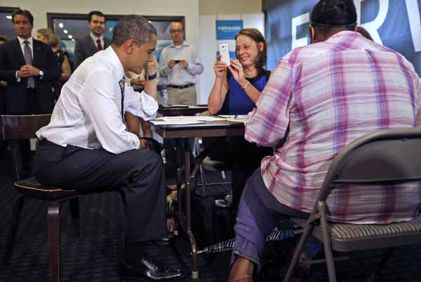 President Barack Obama talks on a cell phone as he makes phone calls from a local campaign office during an unscheduled stop, Thursday, Oct. 25, 2012, in Chicago. The president flew to Chicago to cast his vote, during early voting, in the 2012 election. &#40;AP Photo&#47;Pablo Martinez Monsivais&#41; <span class=meta>(AP Photo&#47; Pablo Martinez Monsivais)</span>