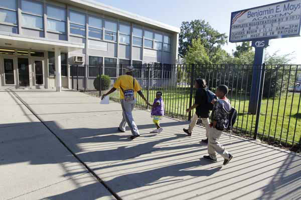Parents drop their children off at Benjamin E. Mays Academy, one of the few schools open for a half day during the first day of a Chicago teachers strike, Monday, Sept. 10, 2012, in Chicago. Thousands of teachers walked off the job in the nation&#39;s third-largest school district for the first time in 25 years after union leaders announced they were far from resolving a contract dispute with school district officials. &#40;AP Photo&#47;M. Spencer Green&#41; <span class=meta>(AP Photo&#47; M. Spencer Green)</span>