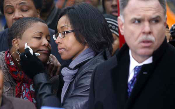 Cleopatra Pendelton, left, is consoled by her sister Kimiko Pettis, during a news conference with Chicago Police Superintendent Garry McCarthy, right, seeking help from the public in solving the murder of Pendelton&#39;s daughter Hadiya Wednesday, Jan. 30, 2013, in Chicago. &#40;AP Photo&#47;Charles Rex Arbogast&#41; <span class=meta>(AP Photo&#47; Charles Rex Arbogast)</span>
