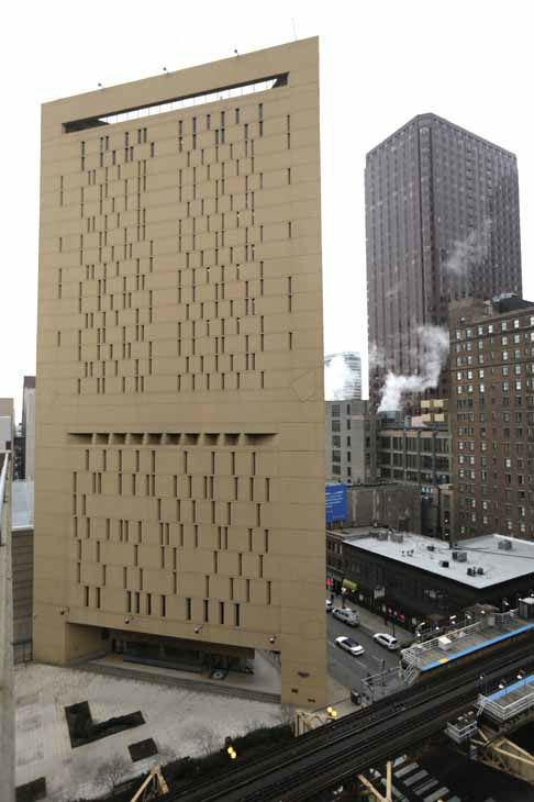 This photo shows the Metropolitan Correctional Center Tuesday, Dec. 18, 2012, in Chicago. Two convicted bank robbers used a knotted rope or bed sheets to escape from the federal prison window high above downtown Chicago early Tuesday, a week after one of them made a courtroom vow of retribution, to federal judge. The escape occurred sometime between 5 a.m. and 8:45 a.m. when the inmates were discovered missing, Chicago Police Sgt. Mark Lazarro said. Hours later, what appeared to be a rope, knotted at six-foot intervals, could be seen dangling into an alley from a window of the Metropolitan Correctional Center approximately 20 stories above the ground. &#40;AP Photo&#47;M. Spencer Green&#41; <span class=meta>(AP Photo&#47; M. Spencer Green)</span>