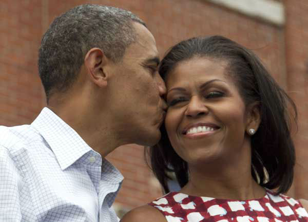 President Barack Obama kisses first lady Michelle Obama on stage at a campaign event at the Alliant Energy Amphitheater, Wednesday, Aug. 15, 2012, in Dubuque, Iowa,  during a three day campaign bus tour through Iowa.  &#40;AP Photo&#47;Carolyn Kaster&#41; <span class=meta>(AP Photo&#47; Carolyn Kaster)</span>