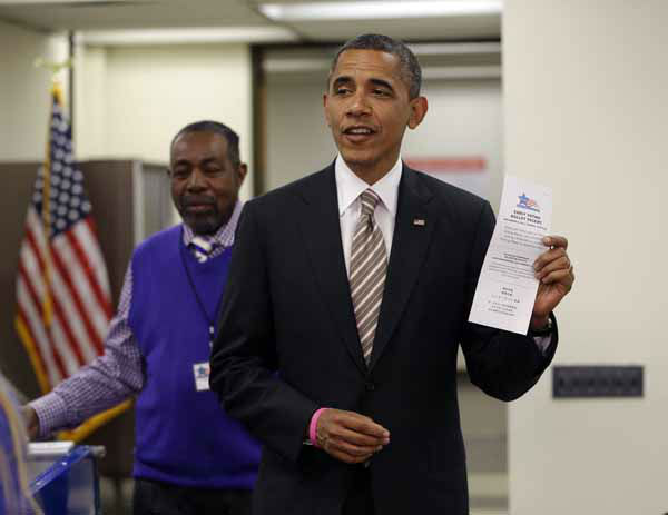 President Barack Obama holds up his early voting ballot receipt after he voted early in the 2012 election at the Martin Luther King Community Center, Thursday, Oct. 25, 2012, in Chicago. &#40;AP Photo&#47;Pablo Martinez Monsivais&#41; <span class=meta>(AP Photo&#47; Pablo Martinez Monsivais)</span>
