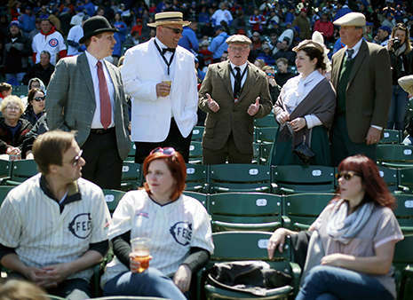 Baseball fans dress in period clothes, top, and the replica 1914 Chicago Federals jersey, bottom left, at the 100th anniversary of the first baseball game at Wrigley Field, before a game between the Arizona Diamondbacks and Chicago Cubs, Wednesday, April 23, 2014, in Chicago. &#40;AP Photo&#47;Charles Rex Arbogast&#41; <span class=meta>(Photo&#47;Charles Rex Arbogast)</span>