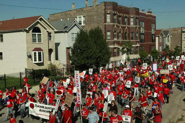 "<div class=""meta image-caption""><div class=""origin-logo origin-image ""><span></span></div><span class=""caption-text"">Striking Chicago school teachers march after a rally Saturday, Sept. 15, 2012 in Chicago. Thousands of striking Chicago public school teachers and their allies packed a city park Saturday in a boisterous show of force as union leaders and the district tried to work out the details of an agreement that could end a week-long walkout.(AP Photo/Sitthixay Ditthavong) (AP Photo/ Sitthixay Ditthavong)</span></div>"