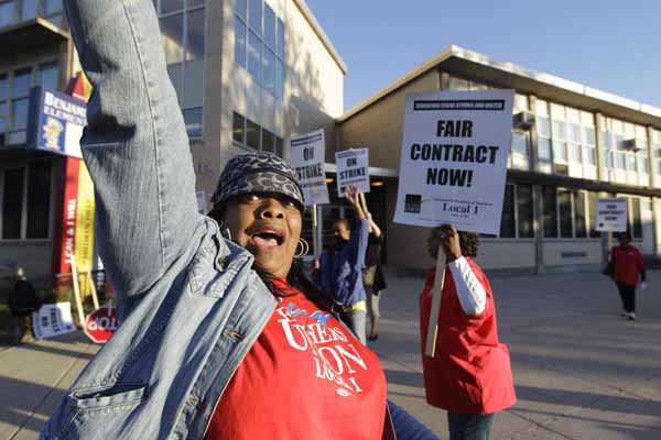 "<div class=""meta ""><span class=""caption-text "">Chicago teachers walk a picket line outside Benjamin Banneker Elementary School in Chicago, Monday, Sept. 10, 2012, after they went on strike for the first time in 25 years. Union and district officials failed to reach a contract agreement despite intense weekend negotiations. (AP Photo/M. Spencer Green) (AP Photo/ M. Spencer Green)</span></div>"