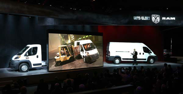 Fred Diaz, President and CEO Truck Brand Chrysler Mexico, talks about the 2014 Ram Promaster 3500 Chassis cab&#47;Cut-away, left, and the Cargo Van at the Chicago Auto Show Thursday, Feb. 7, 2013, in Chicago. &#40;AP Photo&#47;Charles Rex Arbogast&#41; <span class=meta>(AP Photo&#47; Charles Rex Arbogast)</span>