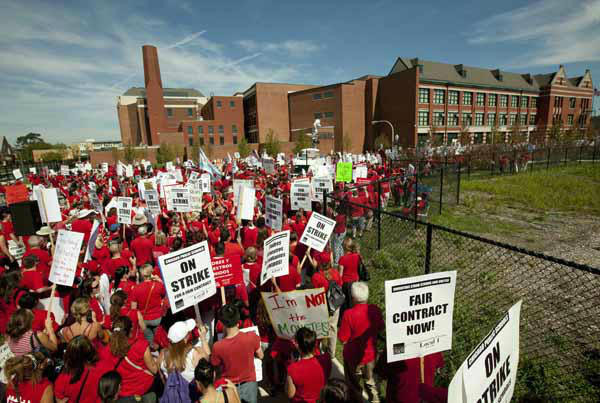 "<div class=""meta ""><span class=""caption-text "">A large group of public school teachers marches past John Marshall Metropolitan High School on Wednesday, Sept. 12, 2012 in West Chicago. Teachers walked off the job Monday for the first time in 25 years over issues that include pay raises, classroom conditions, job security and teacher evaluations. (AP Photo/Sitthixay Ditthavong) (AP Photo/ Sitthixay Ditthavong)</span></div>"