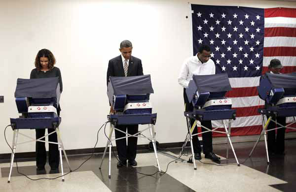 President Barack Obama, second from the left, casts his vote, during early voting, in the 2012 election at the Martin Luther King Community Center, Thursday, Oct. 25, 2012, in Chicago. &#40;AP Photo&#47;Pablo Martinez Monsivais&#41; <span class=meta>(AP Photo&#47; Pablo Martinez Monsivais)</span>