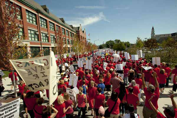 A large group of public school teachers marches past John Marshall Metropolitan High School on Wednesday, Sept. 12, 2012 in West Chicago. Teachers walked off the job Monday for the first time in 25 years over issues that include pay raises, classroom conditions, job security and teacher evaluations. &#40;AP Photo&#47;Sitthixay Ditthavong&#41; <span class=meta>(AP Photo&#47; Sitthixay Ditthavong)</span>