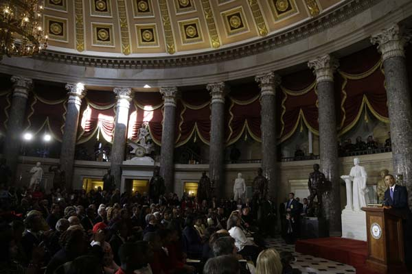 President Barack Obama speaks in the Statuary Hall on Capitol Hill in Washington, Wednesday, Feb. 27, 2013, during the unveiling of a statue of Rosa Parks, second from left.  <span class=meta>(AP Photo&#47;Charles Dharapak)</span>