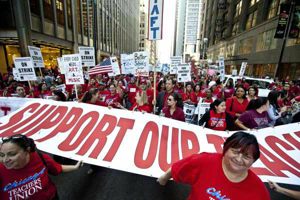 "<div class=""meta ""><span class=""caption-text "">Thousands of public school teachers rally outside Chicago Public Schools district headquarters on the first day of strike action over teachers' contracts on Monday, Sept. 10, 2012 in Chicago. For the first time in a quarter century, Chicago teachers walked out of the classroom Monday, taking a bitter contract dispute over evaluations and job security to the streets of the nation's third-largest city ? and to a national audience ? less than a week after most schools opened for fall. (AP Photo/Sitthixay Ditthavong) (AP Photo/ Sitthixay Ditthavong)</span></div>"