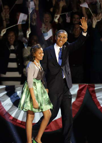 President Barack Obama waves as he walk on the stage with his daughter Malia at his election night party Wednesday, Nov. 7, 2012, in Chicago. President Obama defeated Republican challenger former Massachusetts Gov. Mitt Romney. &#40;AP Photo&#47;Pablo Martinez Monsivais&#41; <span class=meta>(AP Photo&#47; Pablo Martinez Monsivais)</span>