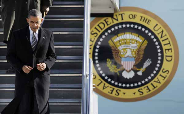 President Barack Obama walks down the stairs from Air Force One upon his arrival at O&#39;Hare International Airport in Chicago, Friday, Feb. 15, 2013. The president traveled to Chicago to pitch his &#34;Ladders of opportunity&#34; economic plan, following his State of the Union address.  &#40;AP Photo&#47;Paul Beaty&#41; <span class=meta>(AP Photo&#47; PAUL BEATY)</span>