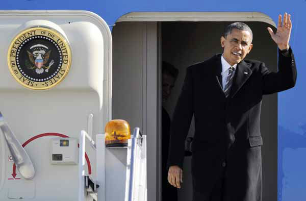 President Barack Obama waves as he gets off Air Force One upon his arrival at O&#39;Hare International Airport in Chicago, Friday, Feb. 15, 2013. The president traveled to Chicago to pitch his &#34;Ladders of opportunity&#34; economic plan, following his State of the Union address. &#40;AP Photo&#47;Paul Beaty&#41; <span class=meta>(AP Photo&#47; Paul Beaty)</span>