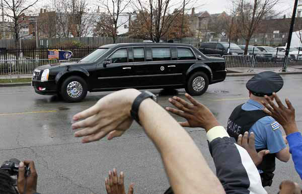 Residents of Chicago&#39;s Bronzeville neighborhood wave at President Obama after he voted early at the Martin Luther King Community Center Thursday, Oct. 25, 2012. President Obama becomes the first president to vote early live. &#40;AP Photo&#47;Charles Rex Arbogast&#41; <span class=meta>(Photo&#47;Charles Rex Arbogast)</span>