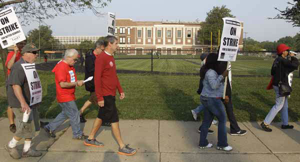 "<div class=""meta image-caption""><div class=""origin-logo origin-image ""><span></span></div><span class=""caption-text"">Smaller, more subdued groups of teachers picket outside Morgan Park High School in Chicago, Monday, Sept. 17, 2012, as a strike by Chicago Teachers Union members heads into its second week. Mayor Rahm Emanuel said he will seek a court order to force the city's teachers back into the classroom. (AP Photo/M. Spencer Green) (AP Photo/ M. Spencer Green)</span></div>"